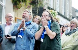 CELEB CHEFS Hairy Bikers David Myers and Simon King watch black pudding throwers,