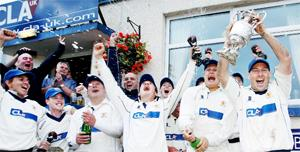 CUP OF CHEERS Lowerhouse players celebrate getting their hands on the Lancashire League title yesterday  Pictures: KIPAX