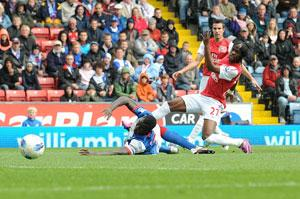 OPENER Arsenal's Yao Gervinho (right) scores the first goal