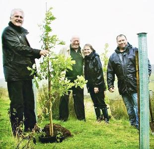 TREE-MENDOUS From left, Alan Butterfield and his father James begin planting at Wheatland Heights with Caroline Thorpe and Simon Smith, of Thorpe Trees.