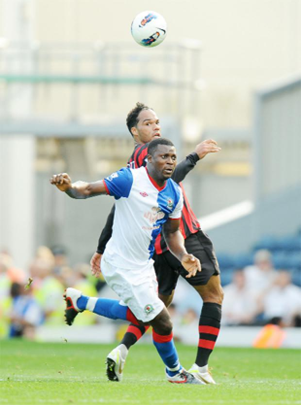 HAVING A BALL Yakubu and Joleon Lescott battle it out