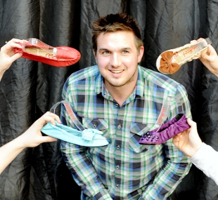 INTO THE DEN Tim with some of his folding shoes from the Redfoot business