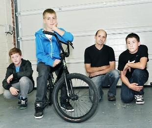 'POLICE WORK' Ian Johnson and his step-son Sam, right, with Sam's friends Jonathan Shaw – who has his bike back – and James Brunton-Whittle