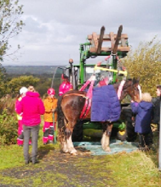 RESCUE Eddie is helped back on his feet after the drama in Tockholes