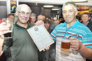 I'M IN CAMRA member Steven Banks, right, receives his certificate and tankard from branch chairman John Webster