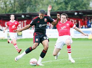 OPENER Kevin McIntyre cannot prevent Jake Jervis putting Swindon in front	Pictures: KIPAX