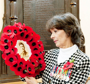 MEMORY Carol Pearson with a wreath to her grandfather