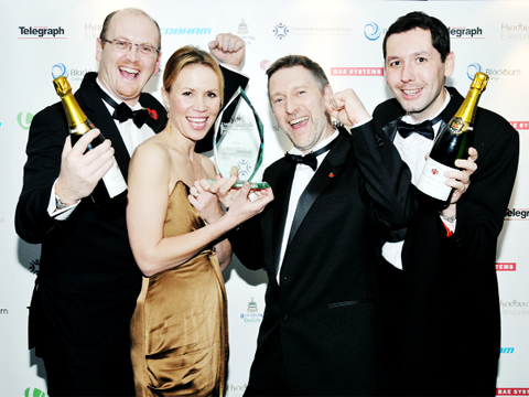 WINNERS! Merc Engineering bosses Nigel Jenkins; production director, John Hoyle; commercial director; and Les Nuttall, managing director, celebrate with compere and TV personality Dianne Oxberry