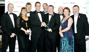 winning TEAM David Hill presents the award to Andrew Buchanan, surrounded by his 'fantastic' colleagues