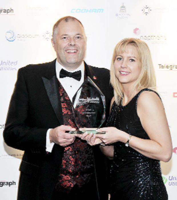 JOB WELL DONE VEKA MD Dave Jones and human resources manager Gabriela Hammond receive the award.