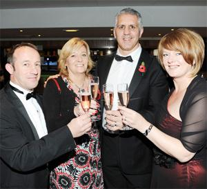 DRINK TO OUR SUCCESS From left, David and Miriam Bailey and Kevin and Angela Singh celebrate Fort Vale's victory