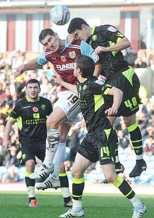 HEADS UP Sam Vokes challenges for a high cross