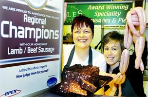 TOP PRODUCT Lara Howarth, left, and Carrie Murray are with the award and some of their award-winning products.