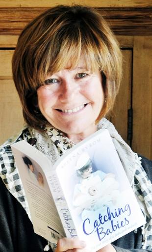 CATCHING UP Recently retired midwife Sheena Byrom with her book Catching Babies