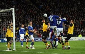 OUT Cardiff City's Anthony Gerrard (third right) scores his sides second goal