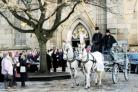 FINAL JOURNEY A glass sided horse-drawn hearse carries Maddi Allan's coffin at Blackburn Cathedral.