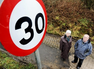 IT'S THE LIMIT Coun Lynn Wilson with the chairman of Great Harwood Regeneration Group John Duckworth, in Clinkham Road and the 30mph sign