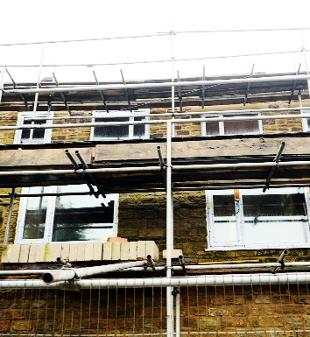EYESORE Scaffolding outside the houses in Burnley Road, Clayton-le-Moors. The owner has now been ordered to put all the work right