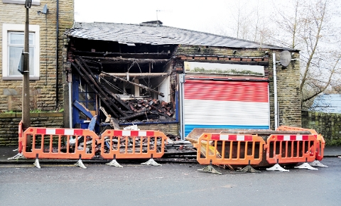 WRECKED The building in Hollingreave Road, Burnley, is cordoned off
