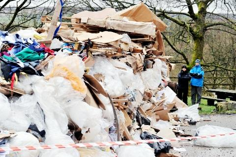 Lancashire Telegraph: FLY-TIPPED Walkers stare in disbelief at the huge mound of rubbish