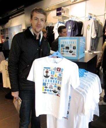 WINNING DESIGN: Left, Andrew Mallalieu in the City Store with his T-shirt