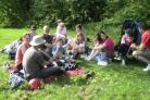 PERFECT SPOT: Some families enjoying a picnic in a meadow