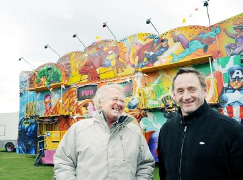 Richard Cubbins and his cousin Ronald in front of the funhouse at the Blackburn Easter Fair on Witton Park