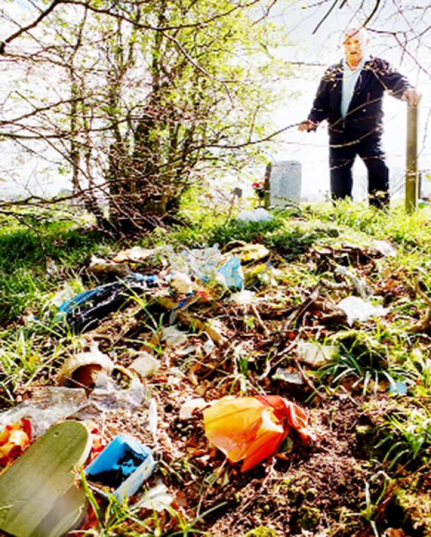 Peter Holden surveys the rubbish dumped near Pleasington cemetery.