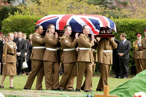 Pallbearers carry the coffin of Lance Corporal Michael Foley.