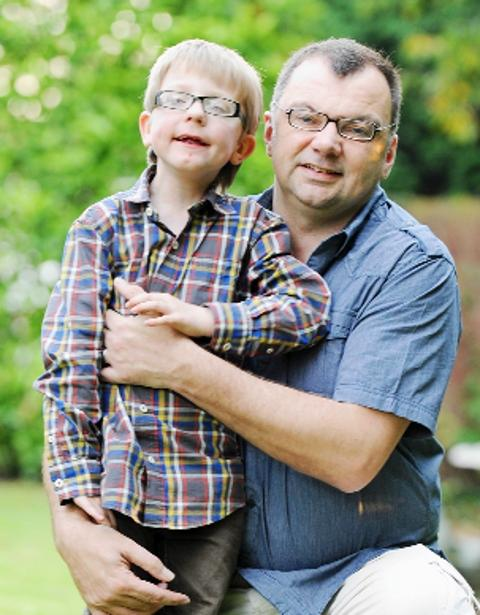 INSPIRATIONAL Six-year-old Jack Entwistle and his dad, Alan
