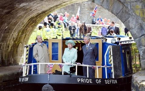 CRUISING The royal party on the canal in Burnley yesterday