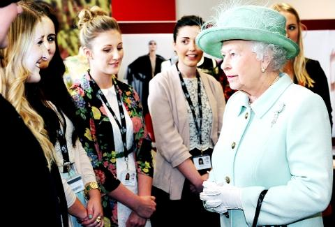 HAPPY AND GLORIOUS The Queen chats to fashion students at the UCLAN Burnley campus