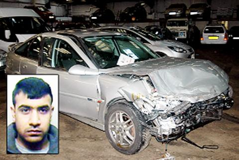 Khalil Hussain and his crumpled Vauxhall Vectra.