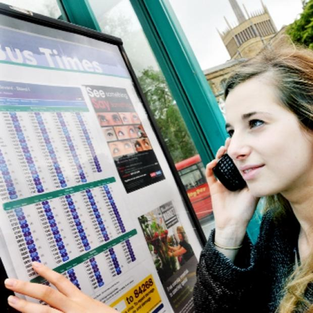 IN PRINT Passenger Jenny Swerdlow checks the times on Blackburn Boulevard