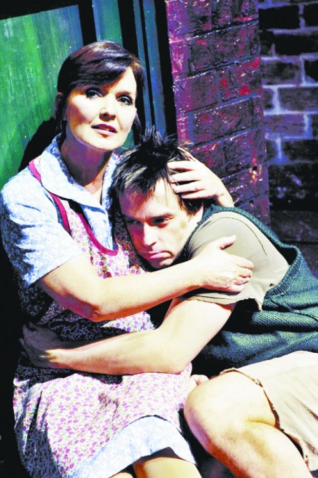 SAD TALE Maureen Nolan as Mrs Johnstone  and Sean Jones as Mickey