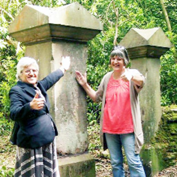 Coun Foster and Rosemary Jackson with the repaired pillars