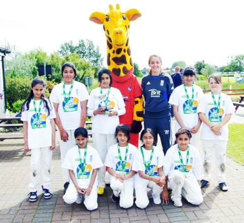 QUEENS OF THE COUNTY Bradley Primary School pupils with county star Kate Cross and Lanky the Giraffe