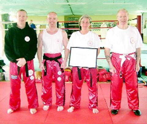 BELTER Mandy Croft shows of her first dan certificate at BMAKB Club