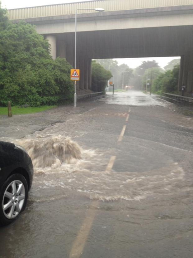 Heavy rain last night caused flooding in Carr Road, Nelson. Photo: Becky Parkinson