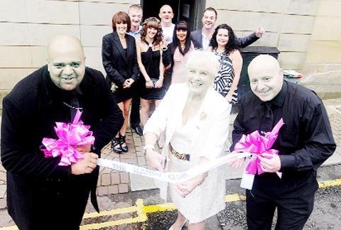 East Lancashire personality Margo Grimshaw officially opens the icandy lap dancing club in Accrington with door security Zed and Mick watched by owner Kate Hartley and well-wishers