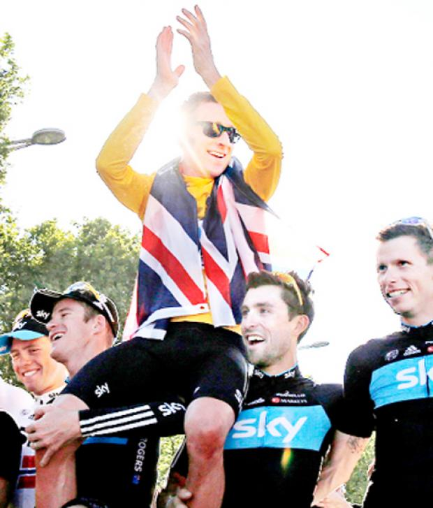 Bradley Wiggins celebrates his victory with team mates on Sunday