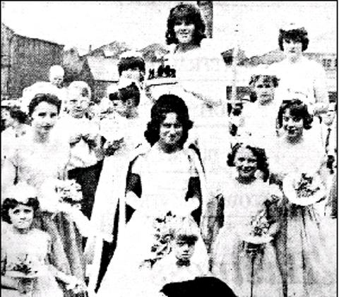 ROYAL DAY Judith, 1964 Worsthorne Carnival queen, is crowned by retiring queen Stella Horsfall