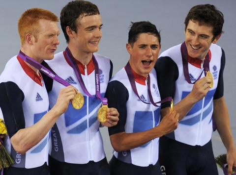 Steven Burke (second from left) collects his gold medal with team mates Peter Kennaugh, Geraint Thomas and Ed Clancy. Photo: PA