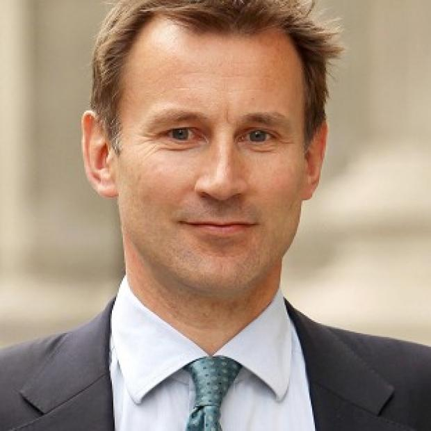 Culture Secretary Jeremy Hunt has been criticised for talking to Rupert Murdoch at an Olympic swimming event