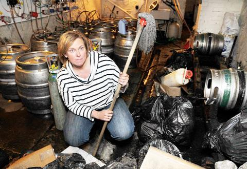 Landlady Christine Fitton in the flood-hit cellar