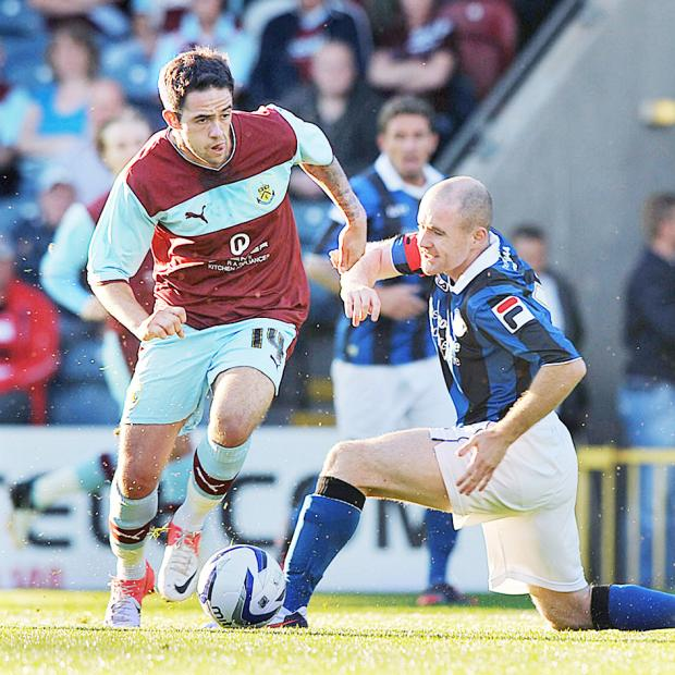WORRY Danny Ings beats former Accrington man Peter Cavanagh last night – but he was injured at Rochdale