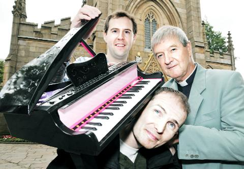 Samuel Hudson, Mark Pickering and Christopher Armstrong with the piano