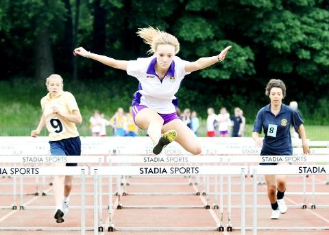 UP AND OVER Action from the girls year 10/11 hurdles final