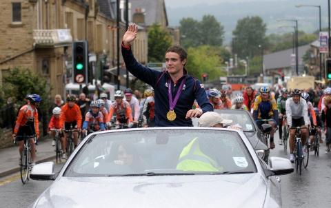 Steven Burke waves to onlookers in Colne