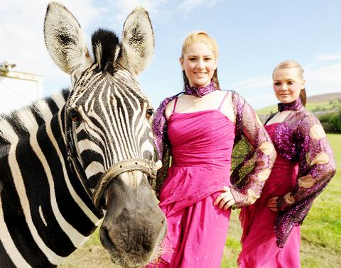 Madalane and Cinzia Timmis of Circus Mondao with Sinbad the Zebra